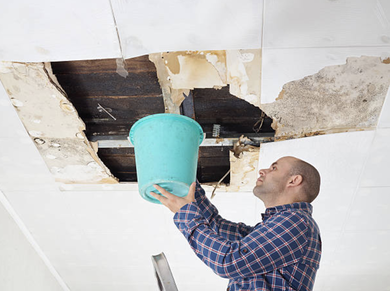 Drywall repairer fixing water damage, hole in ceiling in Hunterdon, NJ